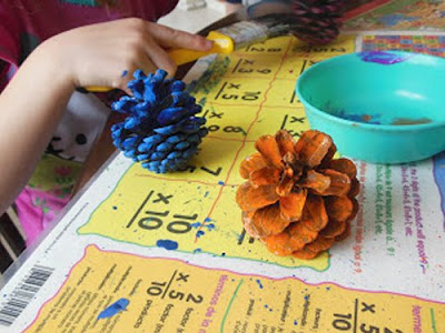 painting pinecones with different colors