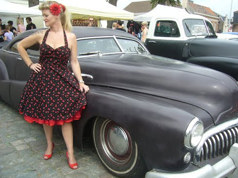 feeling cheeky in this black rockabilly  cherry dress
