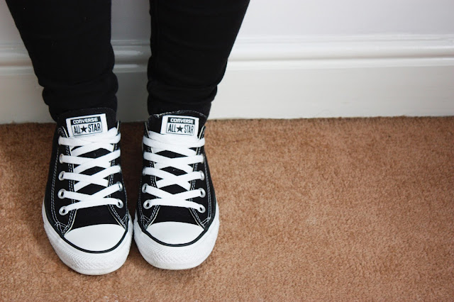 Pair of black and white classic converse