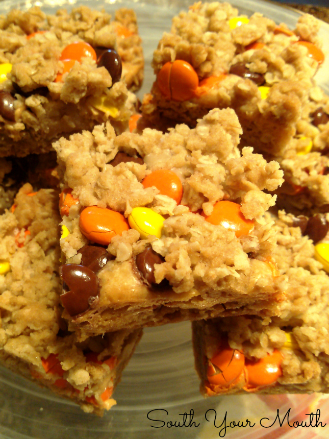 Reese's Peanut Butter Oatmeal Bars! Oatmeal crumble bars with a peanut butter fudge center topped with Reese's Pieces candies.