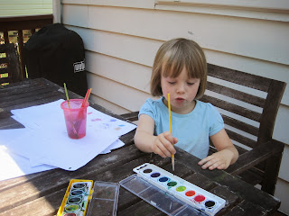 Mabel painting outside