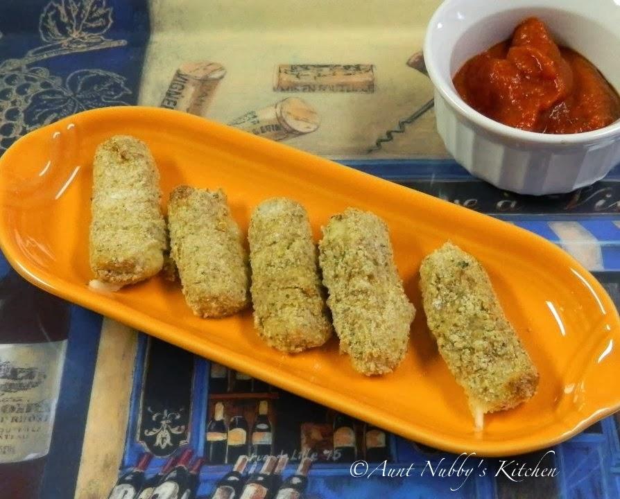 Sugar Spice and Spilled Milk: Baked Mozzarella Sticks