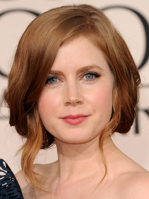 Amy Adams tucked-under strands have a soft, romantic feel.