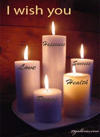 """I wish you happiness, love, success, health, and peace."" Picture of 5 lit candles with the wishes written on them."