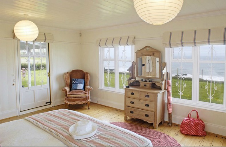 coastal cottage bedroom with ocean view.