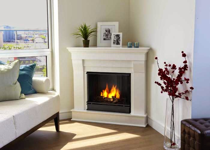 decorating small living room with white corner fireplace including photo frame