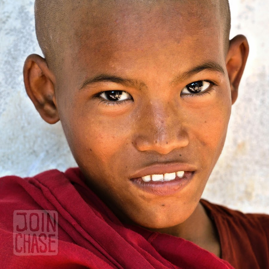 A novice monk posing for a picture near Yangon, Myanmar.