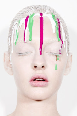 woman with paint dripping down face, beauty