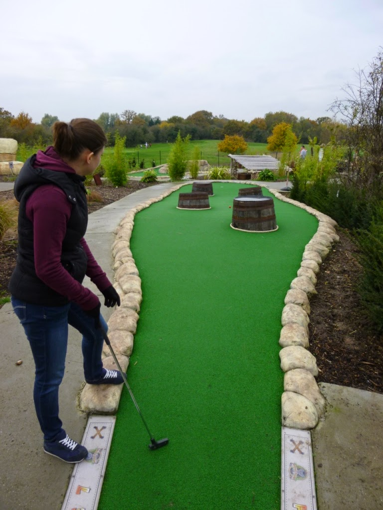 Emily Gottfried in action at the Jungle Island Adventure Golf course at Horton Park Golf Club in Epsom, Surrey