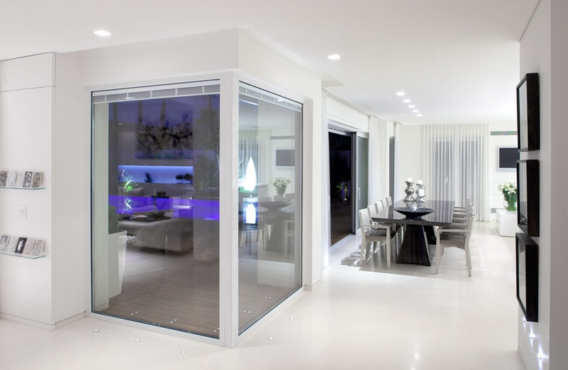 Corner glass wall and White interior design in modern Sea Shell home