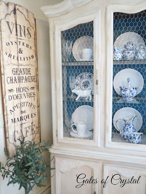 china cabinet makeover with chicken wire doors