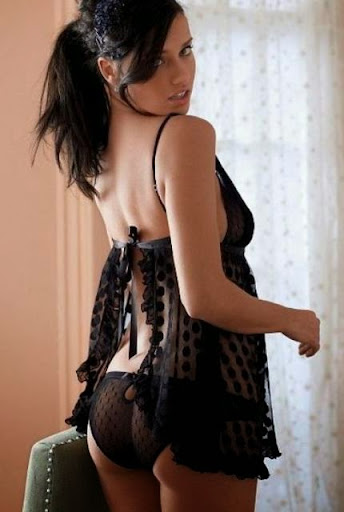 Black hair sexy woman in black lingerie teddy shows nice booty