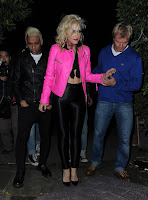 Gwen Stefani tight black pants and pink leather jacket