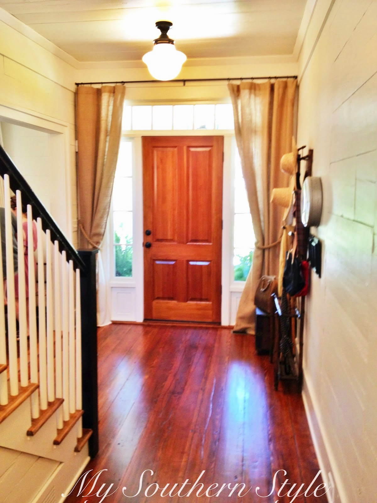 Is a staircase facing the front door bad feng shui the for Feng shui bedroom door facing stairs