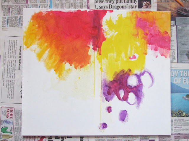 Paint abstract art with melted crayons.