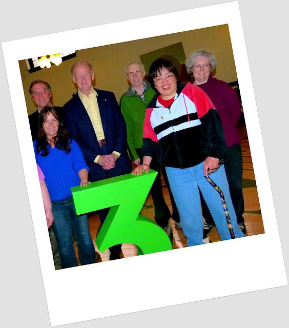 Hall members standing around John Ralston Saul