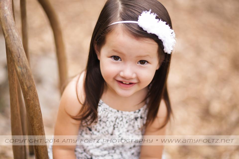 portrait of toddler girl smiling