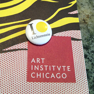 Roy Lichetenstein retrospective button photo via Beaver Button Company