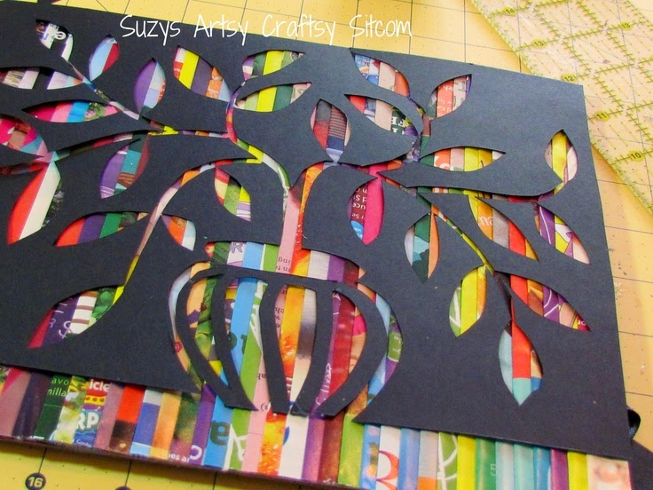http://suzyssitcom.com/2012/06/feature-friday-cut-paper-art.html