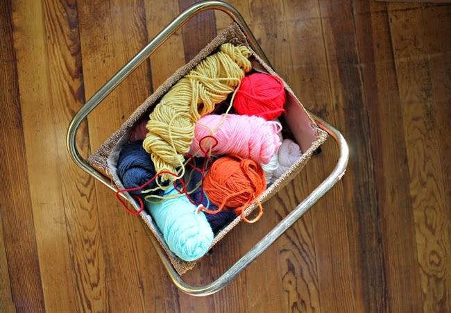 vintage yarn basket full of colorful yarn