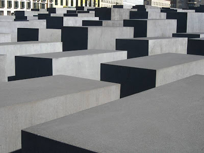 Large grey/black blocks commemorating the Holocaust in a Berlin square