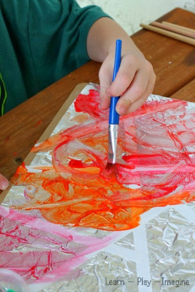 Cool art for kids - tape resist art on a foil canvas