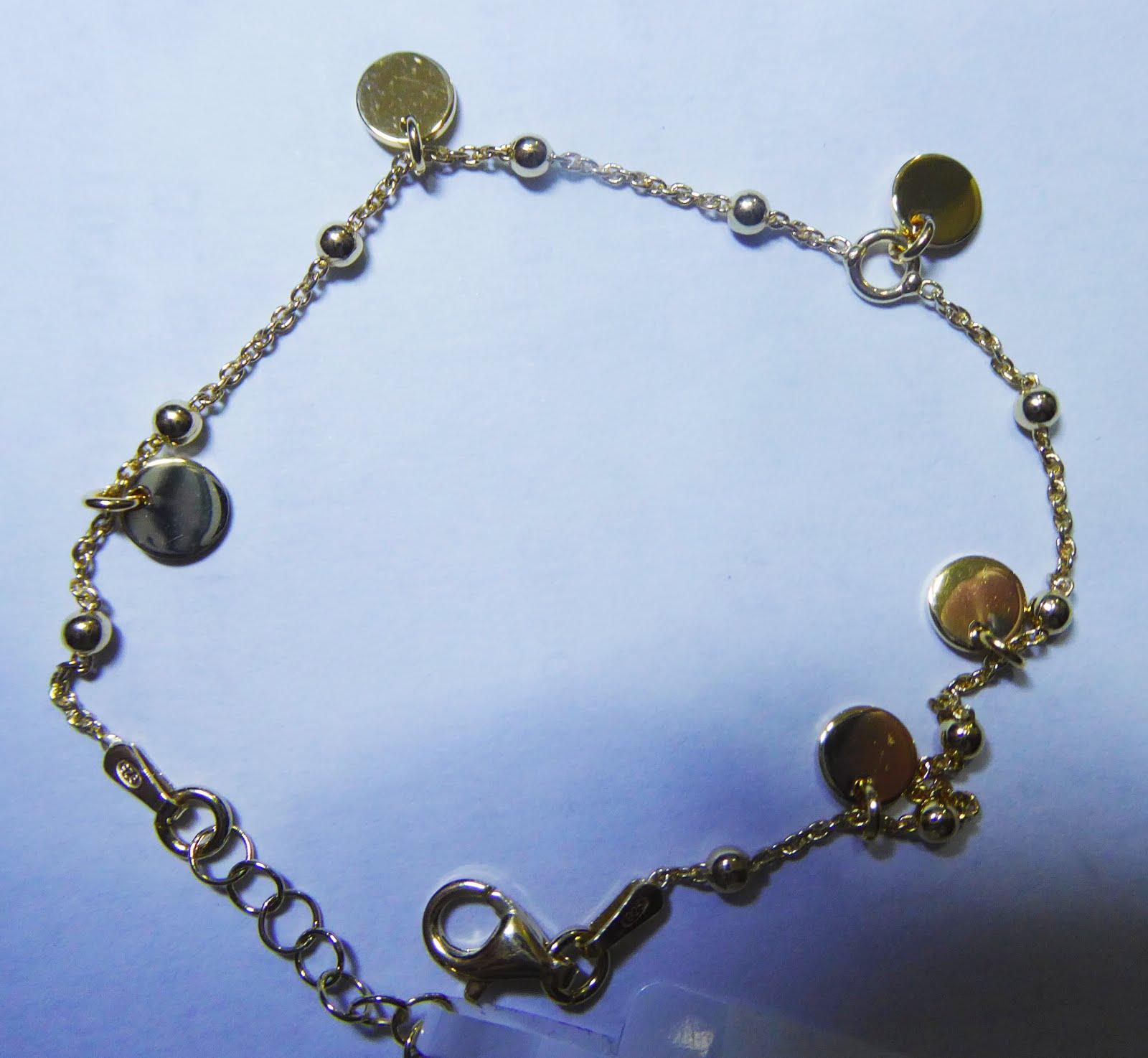 Pulsera de plata dorada con colgantes