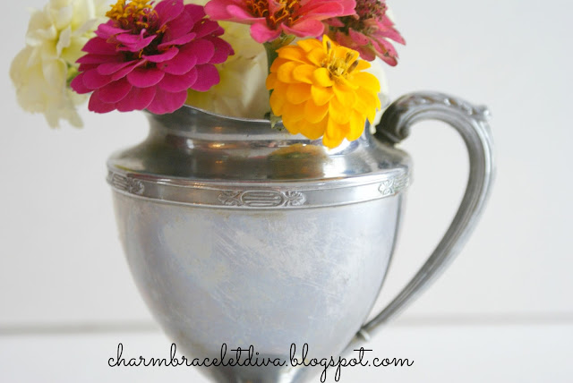 Vintage silver plate pitcher with detailed etching