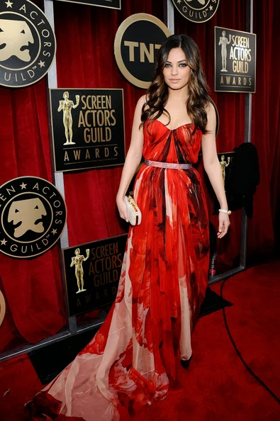 Mila Kunis in a flowing Alexander McQueen abstract print red chiffon evening dress with a long train at the 17th Annual Screen Actors Guild Awards held at The Shrine Auditorium on January 30, 2011 in Los Angeles, California.