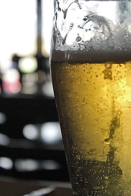 close up of a beer glass with beer