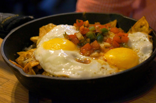 Breakfast food, Huevos Rancheros with eggs, cheese, avacodo, nacho's, mexican style breakfast