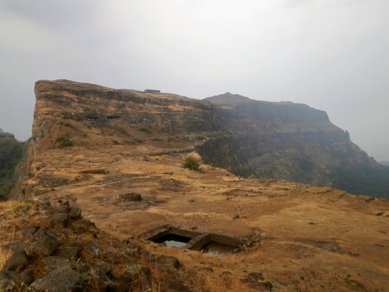 We reach on top of Alang - water tanks, the cave where we were to stay and an old ruined store house on the summit can be seen here
