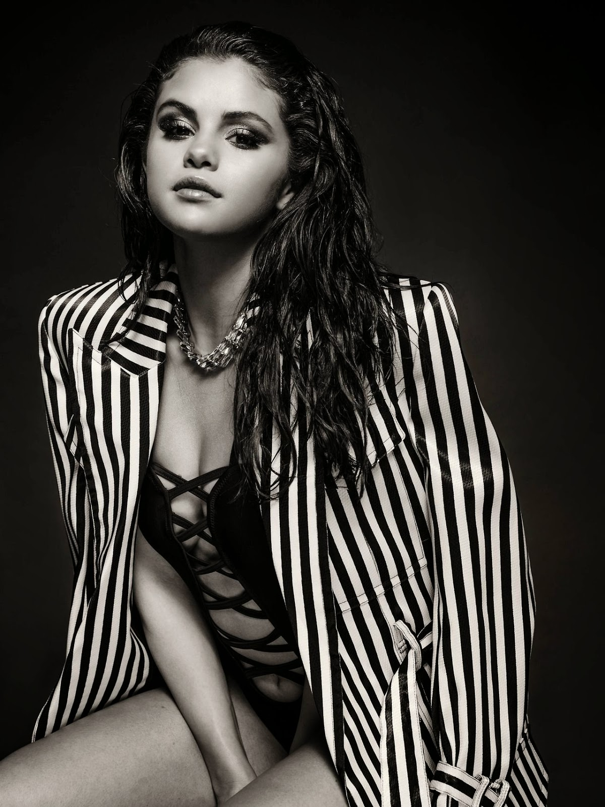 Selena Gomez sizzles in a swimsuit and blazer look for new photoshoot