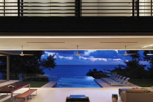 Photo of dusk ocean view from the living room of modern villa