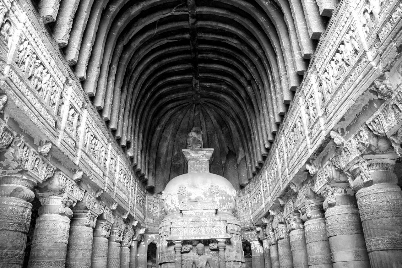 The ornate columns and the vaulted ceiling