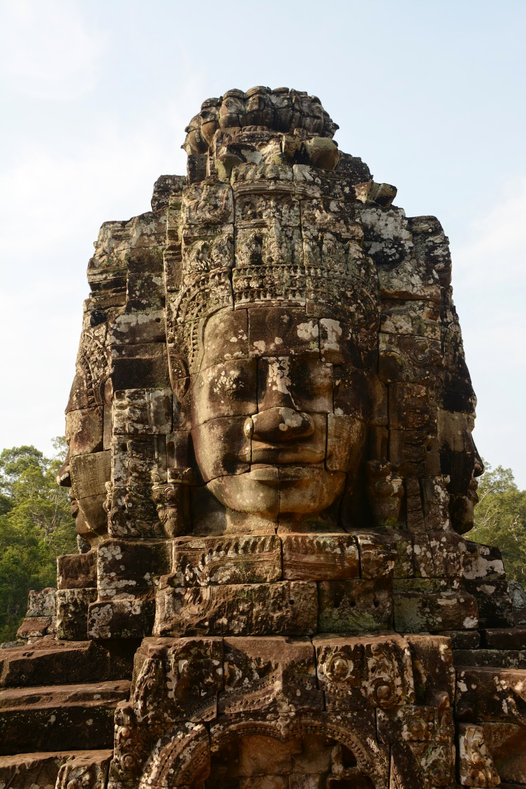 angkor wat cambodia top tips travel holiday vacation buddha head statute