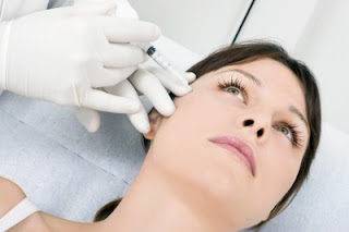 Woman injecting botox