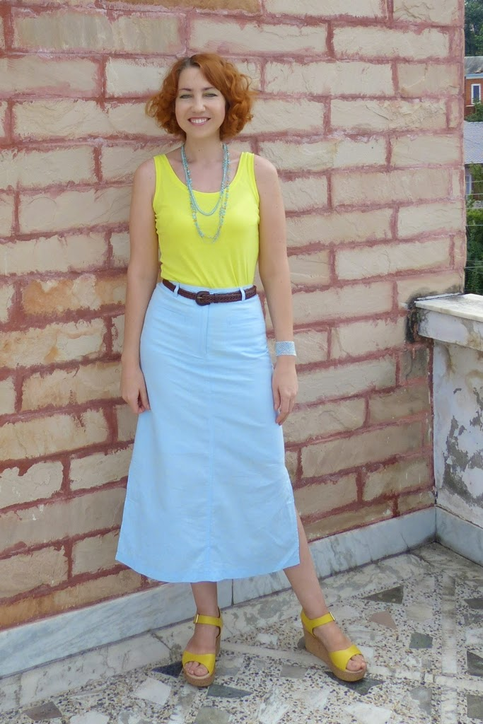Yellow top worn with light blue skirt and yellow sandals
