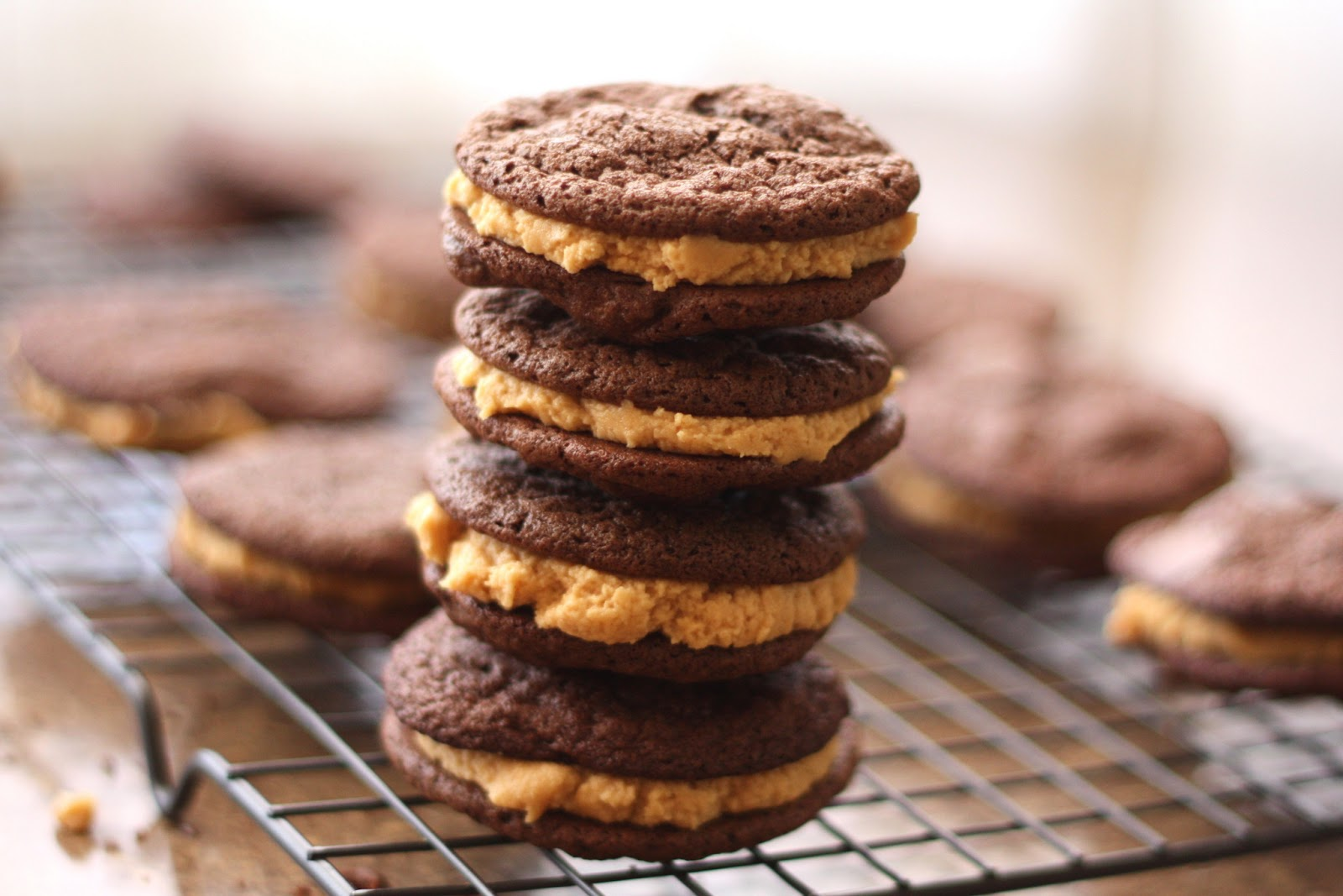 peanut butter cream sandwiched between dark chocolate sandwich cookies ...