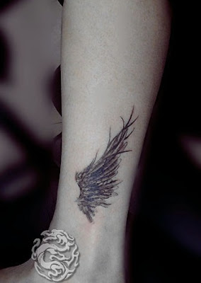 angel wing tattoo on the ankle
