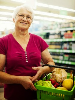 Mature shopper in supermarket with basket