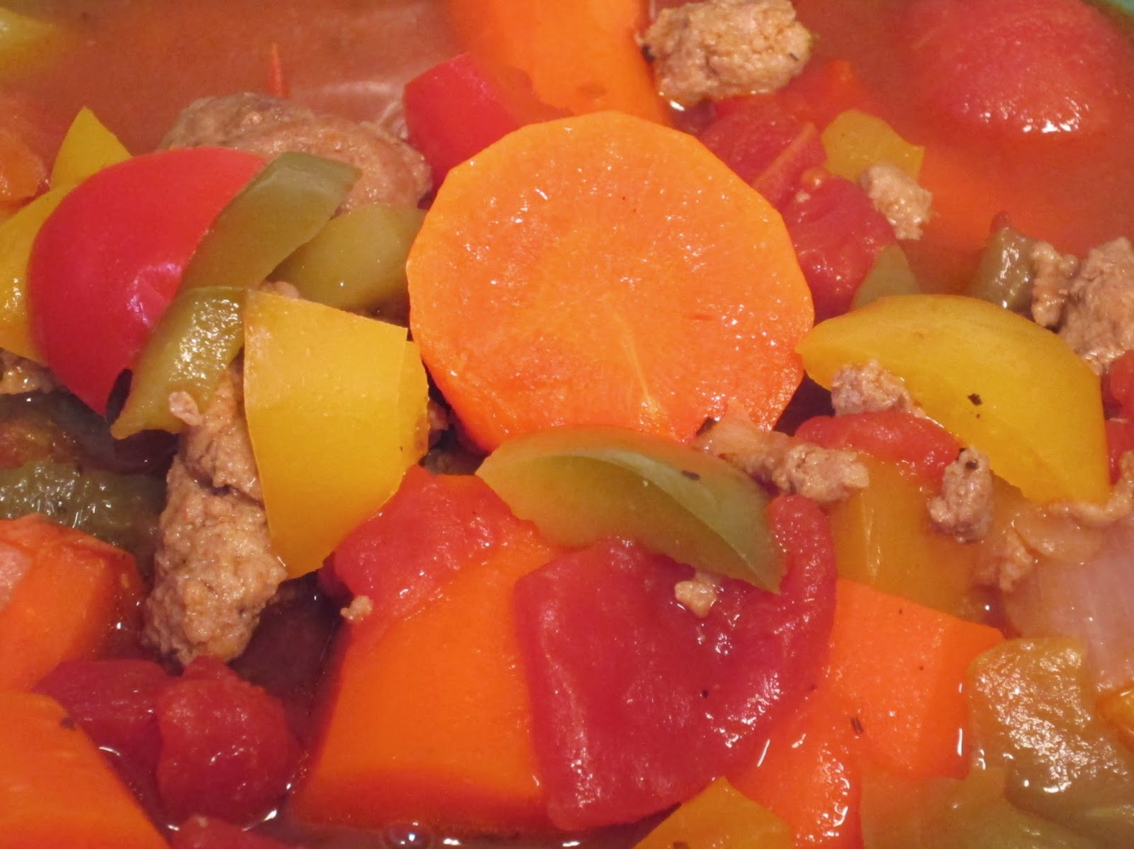 Carrots, bell peppers, tomatoes, and ground turkey in a chicken broth.