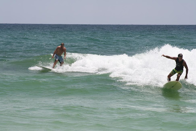Kendall Roose and other surfer Surfing at Pensacola Beach on Sunday May 13, 2012