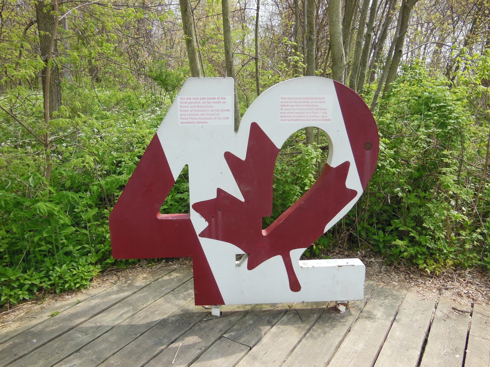 sign marking the 42nd parallel which places Point Pelee on the same ...