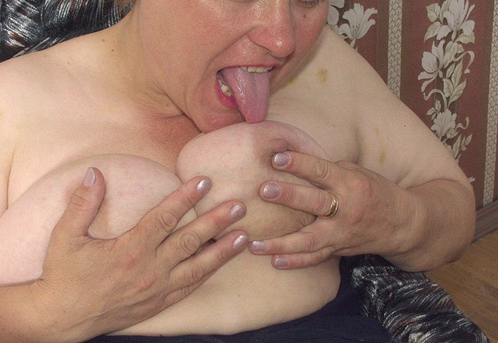 Blonde fat granny squeezing and licks her own mature breasts