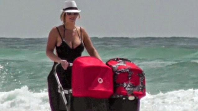 Kim Zolciak was spotted enjoying a vacation at Destin, Florida on Wednesday, April 9, 2014 with family.