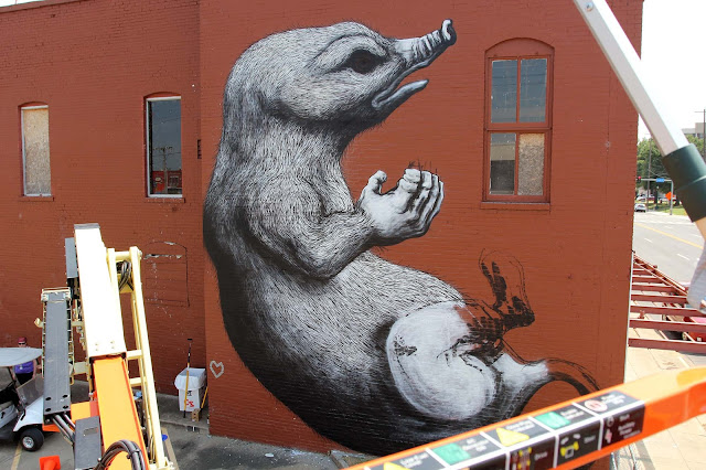 While we last heard from him in San Juan, Puerto Rico, ROA has now reached Arkansas and the lovely city of Fort Smith for the Unexpected Festival which is curated by JustKids.