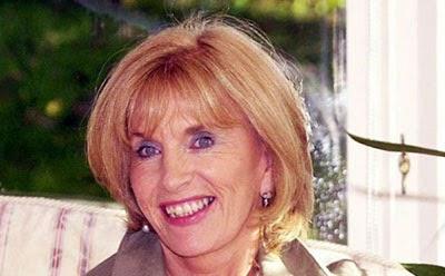 Former bus conductress Ann Gloag OBE
