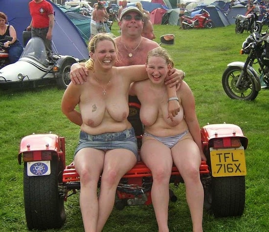 man with daughter in topless