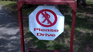 """sign that says """"please drive"""""""